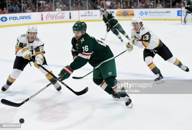 Jason Zucker of the Minnesota Wild passes the puck away from Cody Eakin and Brendan Leipsic of the Vegas Golden Knights during the second period of...