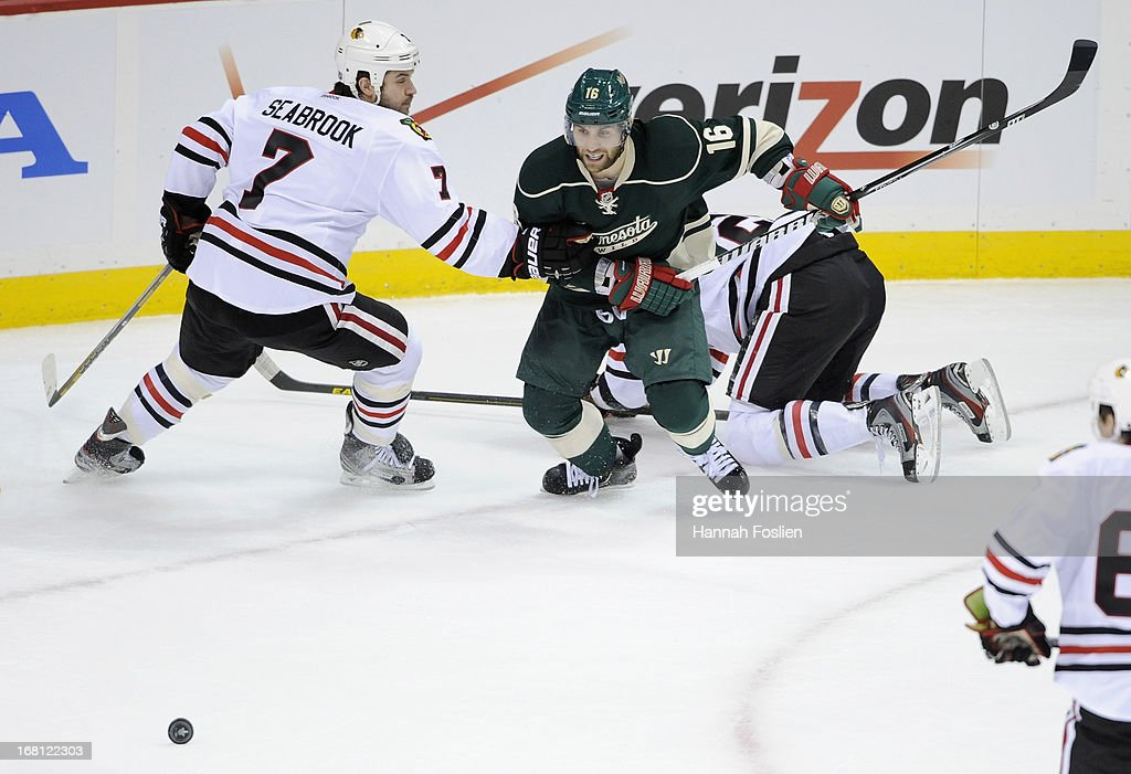<a gi-track='captionPersonalityLinkClicked' href=/galleries/search?phrase=Jason+Zucker&family=editorial&specificpeople=6670470 ng-click='$event.stopPropagation()'>Jason Zucker</a> #16 of the Minnesota Wild skates after the puck against <a gi-track='captionPersonalityLinkClicked' href=/galleries/search?phrase=Brent+Seabrook&family=editorial&specificpeople=638862 ng-click='$event.stopPropagation()'>Brent Seabrook</a> #7 of the Chicago Blackhawks during the first period of Game Three of the Western Conference Quarterfinals during the 2013 NHL Stanley Cup Playoffs at Xcel Energy Center on May 5, 2013 in St Paul, Minnesota. The Wild defeated the Blackhawks 3-2 in overtime.