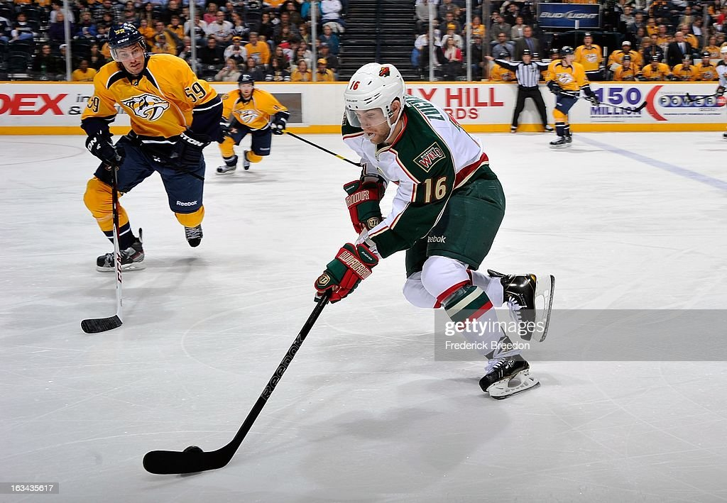 Jason Zucker #16 of the Minnesota Wild skates against <a gi-track='captionPersonalityLinkClicked' href=/galleries/search?phrase=Roman+Josi&family=editorial&specificpeople=4247871 ng-click='$event.stopPropagation()'>Roman Josi</a> #59 of the Nashville Predators at Bridgestone Arena on March 9, 2013 in Nashville, Tennessee.