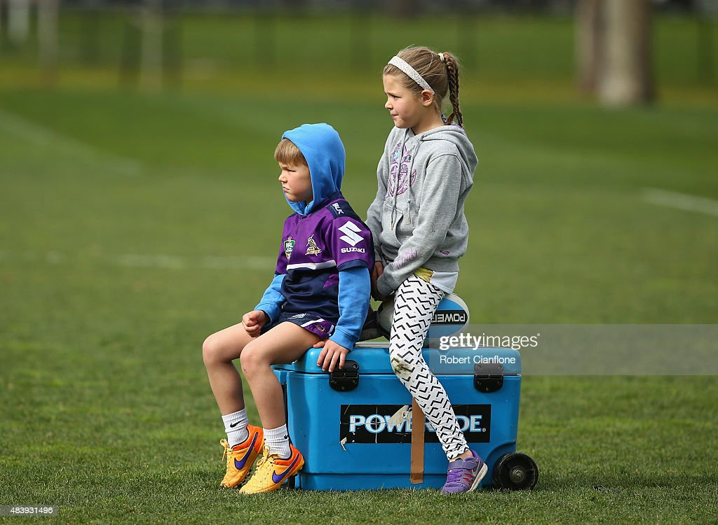 Jasper and Jada Smith watch as their father Cameron Smith trains during a Melbourne Storm NRL training session at Gosch's Paddock on August 14, 2015 in Melbourne, Australia.