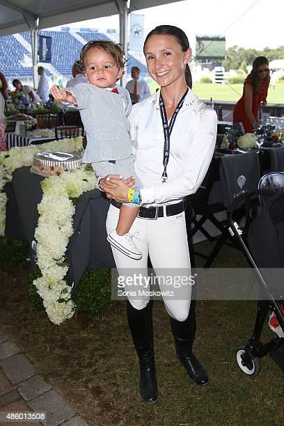 Jasper Bloomberg and Georgina Bloomberg attend the 2015 Hampton Classic Grand Prix on August 30 2015 in Bridgehampton New York