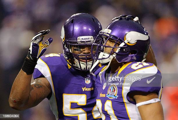 Jasper Brinkley and Josh Robinson of the Minnesota Vikings celebrate during the game against the Chicago Bears on December 9 2012 at Mall of America...