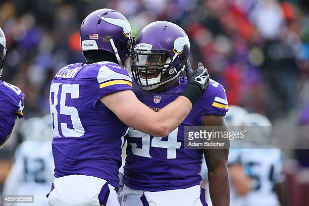 Jasper Brinkley and Rhett Ellison of the Minnesota Vikings celebrate a touchdown against the Carolina Panthers in the second quarter on November 30...