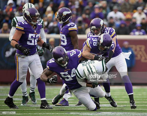 Jasper Brinkley Robert Blanton and Harrison Smith of the Minnesota Vikings tackle Percy Harvin of the New York Jets in the fourth quarter on December...