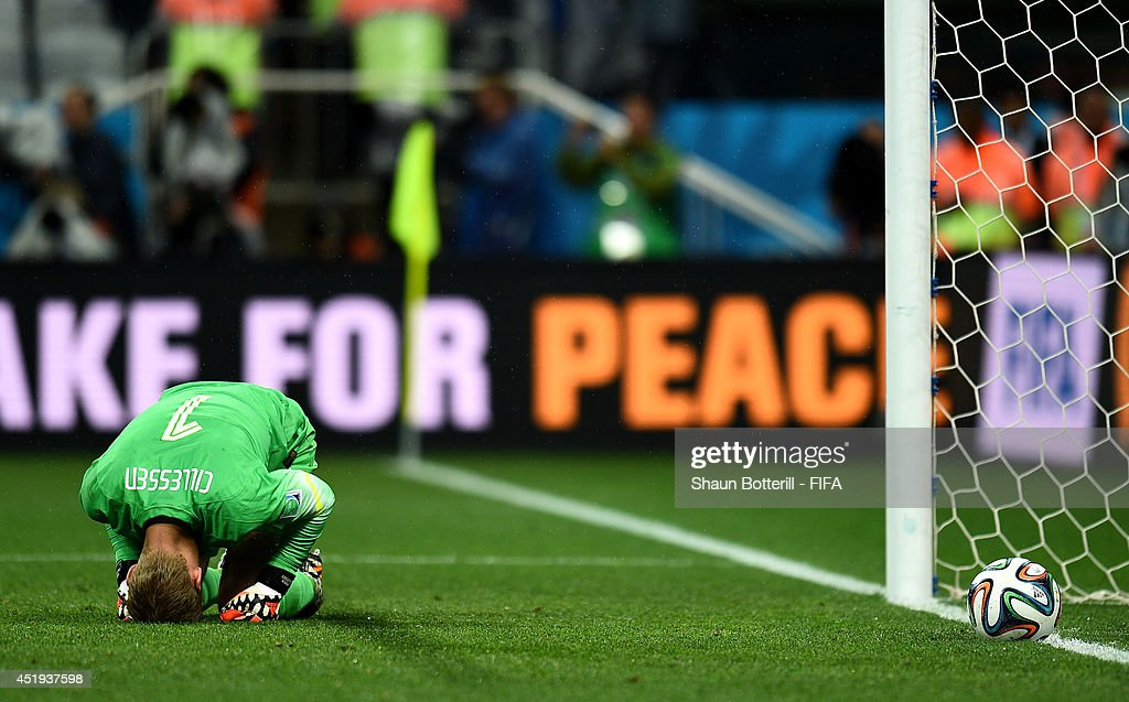 Jasper Cillessen of the Netherlands show his dejection after failing to stop the penalty by Maxi Rodriguez of Argentina in the penalty shootout in the 2014 FIFA World Cup Brazil Semi Final match between Netherlands and Argentina at Arena de Sao Paulo on July 9, 2014 in Sao Paulo, Brazil.