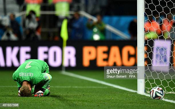 Jasper Cillessen of the Netherlands show his dejection after failing to stop the penalty by Maxi Rodriguez of Argentina in the penalty shootout in...