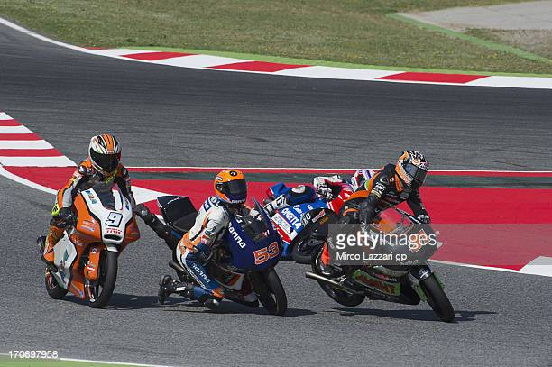 Jasper Iwema of Netherlands and RW Racing GP and Niklas Ajo of Finland and Avant Tecno crashed out during the Moto3 race during the MotoGp Of...