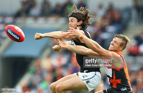 Jasper Pittard of the Power and Rhys Palmer of the Giants contest a mark during the round four AFL match between the Greater Western Sydney Giants...