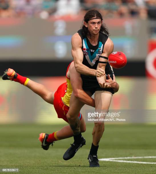 Jasper Pittard of the Power is tackled by Brad Scheer of the Suns during the 2017 AFL round 08 match between the Gold Coast Suns and Port Adelaide...