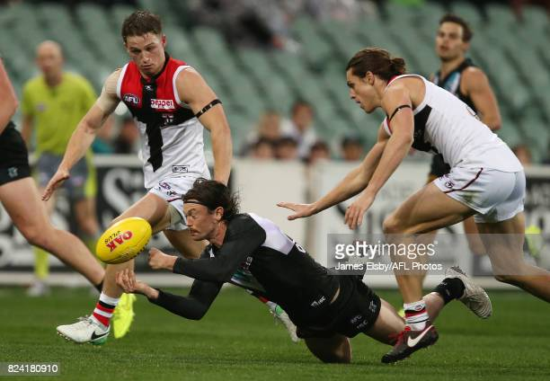 Jasper Pittard of the Power is tackled by Jack Steele of the Saints during the 2017 AFL round 19 match between the Port Adelaide Power and the St...