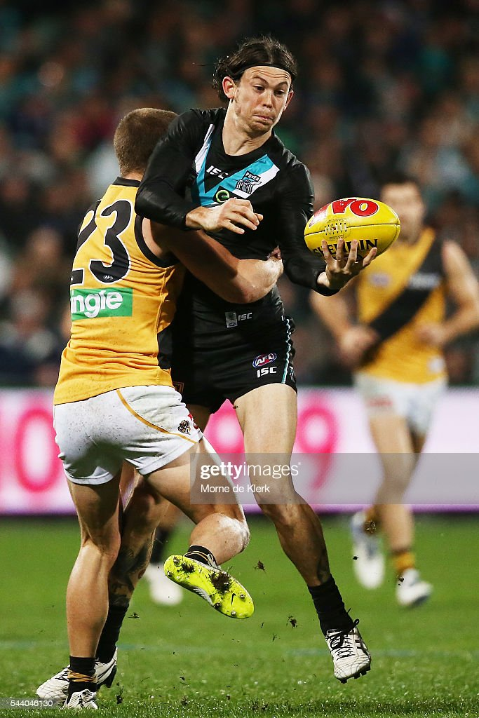 Jasper Pittard of the Power is tackled during the round 15 AFL match between the Port Adelaide Power and the Richmond Tigers at Adelaide Oval on July 1, 2016 in Adelaide, Australia.