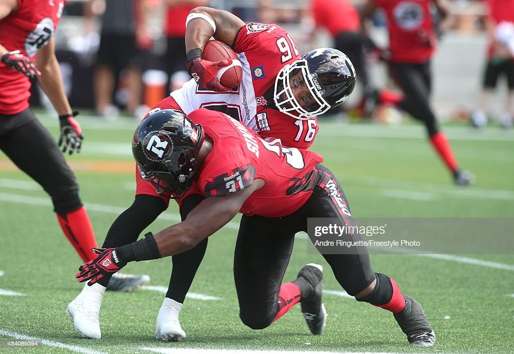 Jasper Simmons #31 of the Ottawa Redblacks tackles Marquay McDaniel #16 of the Calgary Stampeders during the second quarter of a CFL game at TD Place Stadium on August 24, 2014 in Ottawa, Ontario, Canada.