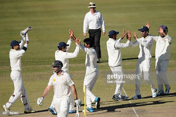 Jasprit Bumrah of India A celebrates with teammates the wicket of Alex Doolan of Australia A during the Quadrangular Series match between Australia A...