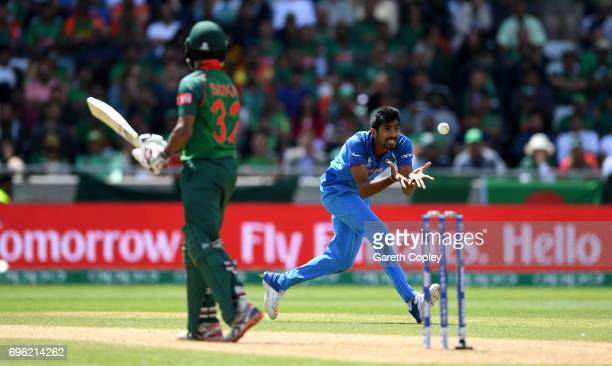 Jasprit Bumrah of India catches out Mosaddek Hossain of Bangladesh during the ICC Champions Trophy Semi Final between Bangladesh and India at...