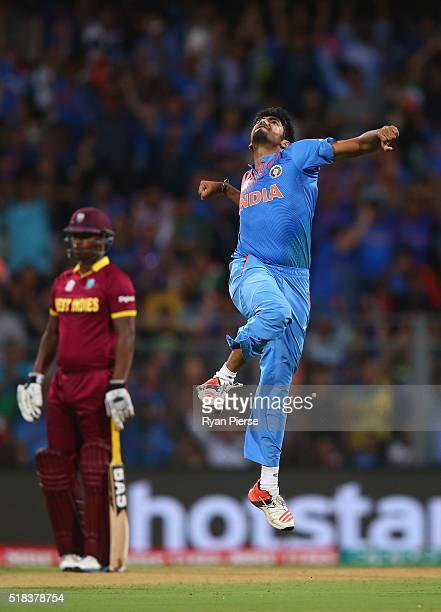 Jasprit Bumrah of India celebrates after taking the wicket of Chris Gayle of the West Indies during the ICC World Twenty20 India 2016 Semi Final...