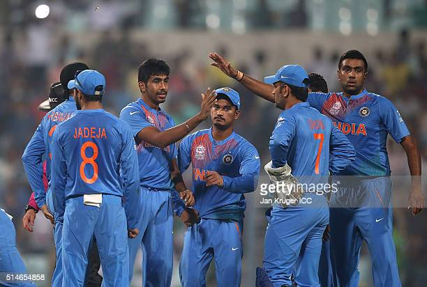 Jasprit Bumrah of India celebrates the wicket of Chris Gayle of the West Indies during the ICC World Twenty20 warm up match between India and West...