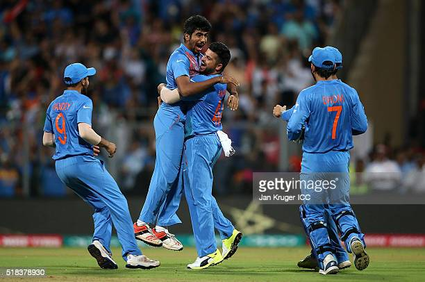 Jasprit Bumrah of India celebrates the wicket of Chris Gayle of the West Indies with team mates during the ICC World Twenty20 India 2016 SemiFinal...