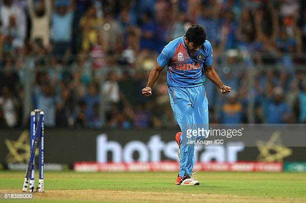 Jasprit Bumrah of India celebrates the wicket of Chris Gayle of the West Indies during the ICC World Twenty20 India 2016 SemiFinal match between West...