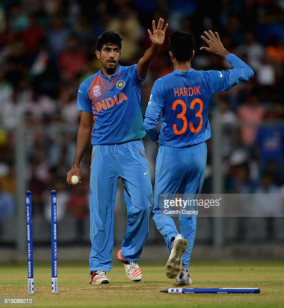 Jasprit Bumrah of India celebrates with Hardik Pandya after bowling Chris Morris of South Africa during the ICC Twenty20 World Cup warm up match...