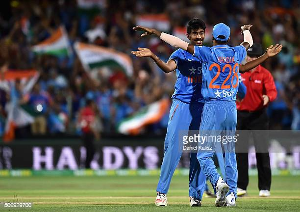 Jasprit Bumrah of India celebrates with Hardik Pandya of India after taking a catch to dismiss Cameron Boyce of Australia and to win the game for...