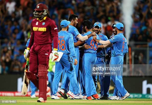 Jasprit Bumrah of India is congratulated by team mates after bowling Chris Gayle of the West Indies during the ICC World Twenty20 India 2016...