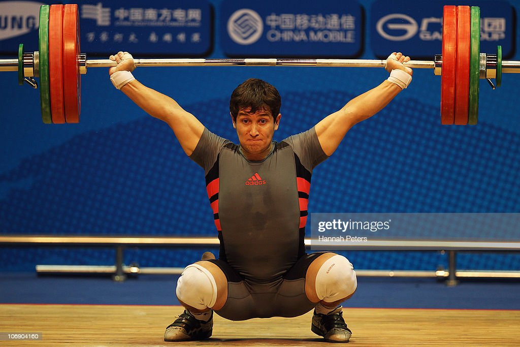 Jasurbek Jumayev of Turkmenistan competes in the Men's Weightlifting 77kg competition during day four of the 16th Asian Games Guangzhou 2010 at Dongguan Gymnasium on November 16, 2010 in Guangzhou, China.