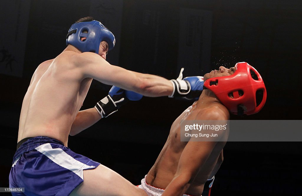 Jasvir Jasvir (Red) of AOI (Independent Olympic Athletes) competes with Ahn Jae-Yeong (Blue) of South Korea in the Kickboxing, Full Contact Men's 81kg Round of 16 at Dowon Gymnasium during day five of the 4th Asian Indoor Martial Arts Games on July 3, 2013 in Incheon, South Korea.