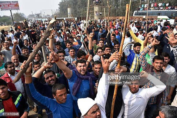 Jat community members protest demanding reservation in government services on February 20 2016 in Bahadurgarh India A mob of around 10000 people...