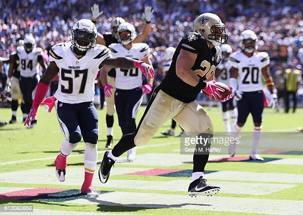 Jatavis Brown of the San Diego Chargers pursues John Kuhn of the New Orleans Saints as Kuhn scores a touchdown against the San Diego Chargers in the...