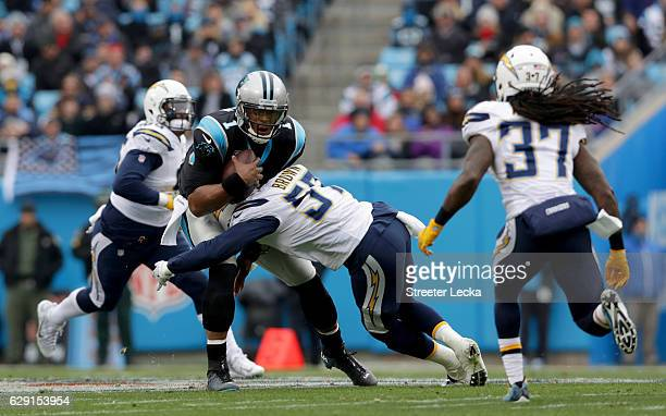 Jatavis Brown of the San Diego Chargers tackles Cam Newton of the Carolina Panthers during their game at Bank of America Stadium on December 11 2016...