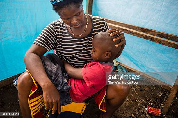 Jatu Zombo check out her son Foday Zombo who became ill days ago on outside the JFK treatment facility on Saturday September 13 2014 in Monrovia...