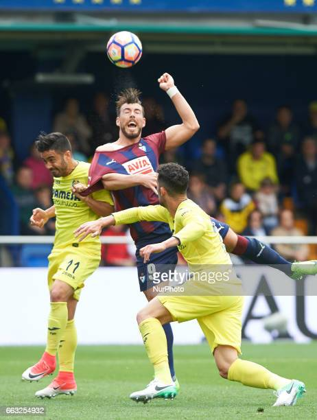 Jaume Costa of Villarreal CF and Sergi Enrich of SD Eibar during their La Liga match between Villarreal CF and SD Eibar at the Estadio de La Ceramica...