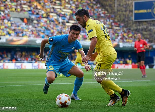 Jaume Costa of Villarreal competes for the ball with Abzal Beysebekov of Astana during the UEFA Europa League group A match between Villarreal CF and...