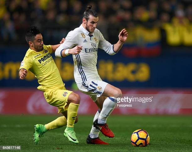 Jaume Costa of Villarreal competes for the ball with Gareth Bale of Real Madrid during the La Liga match between Villarreal CF and Real Madrid at...