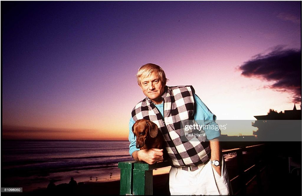 Jaunary 1994 Malibu CaDavid Hockney At Sunset With One Of His Dachshunds Stands On The Deck Of His Malibu Beach Home
