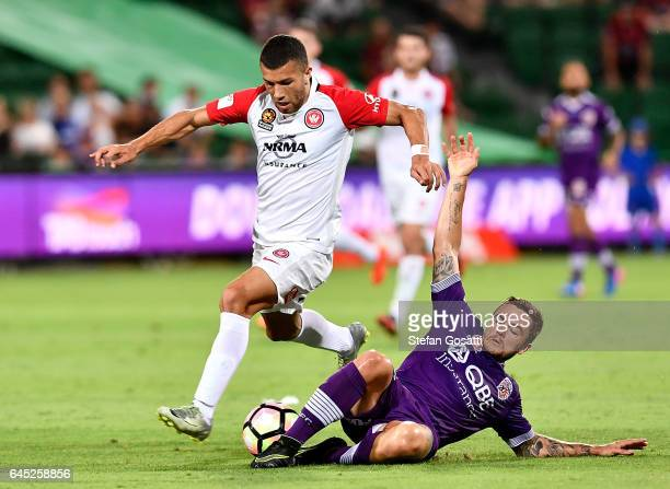 Jaushua Sotirio of the Wanderers and Josh Risdon of the Glory compete for the ball during the round 21 ALeague match between the Perth Glory and...