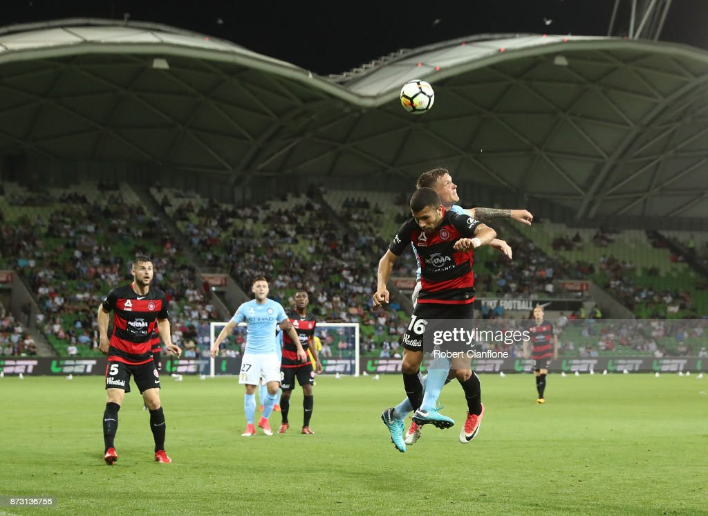 Jaushua Sotirio of the Wanderers and Michael Jakobsen of the City compete for the ball during the round six A-League match between Melbourne City and the Western Sydney Wanderers at AAMI Park on November 12, 2017 in Melbourne, Australia.
