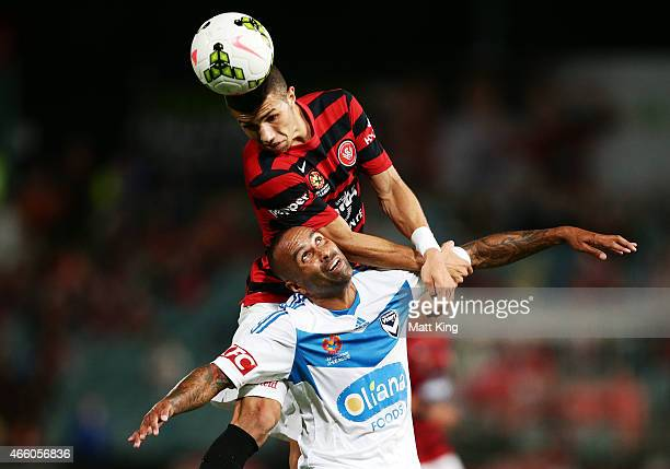 Jaushua Sotirio of the Wanderers is challenged by Archie Thompson of Melbourne Victory during the round 21 ALeague match between the Western Sydney...
