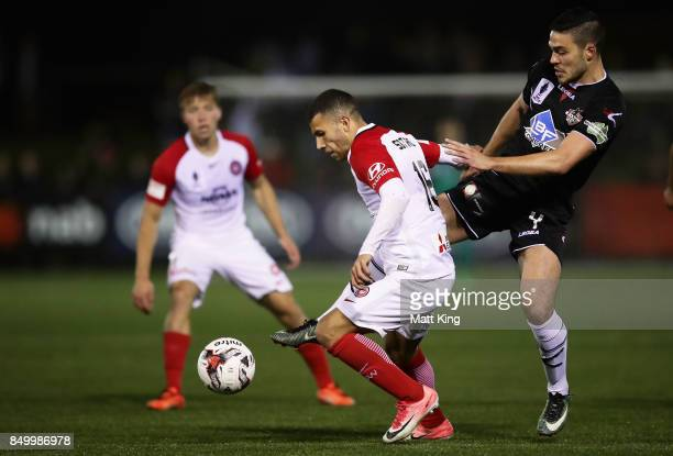 Jaushua Sotirio of the Wanderers is challenged by Robert Speranza of Blacktown City during the FFA Cup Quarterfinal match between Blacktown City and...