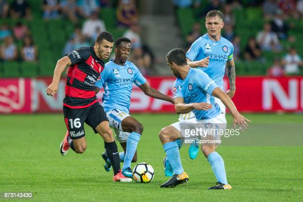Jaushua Sotirio of the Western Sydney Wanderers controls the ball in front of Emmanuel Muscat of Melbourne City and Bruce Kamau of Melbourne City...
