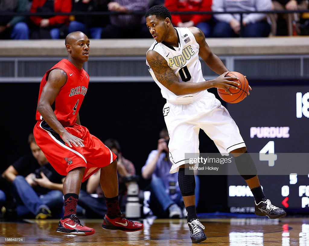 Jauwan Scaife #4 of the Ball State Cardinals guards Terone Johnson #0 of the Purdue Boilermakers at Mackey Arena on December 18, 2012 in West Lafayette, Indiana. Purdue defeated Ball State 66-56.