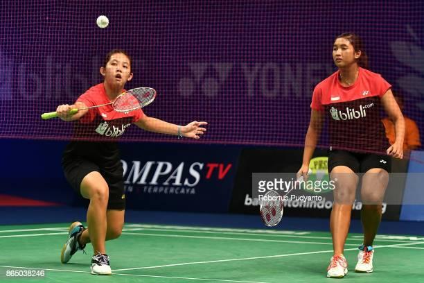 Jauza Fadhila Sugiarto and Ribka Sugiarto of Indonesia compete against Ha Na Baek and Lee Yu Rim of Korea during Women's Doubles Final match of the...