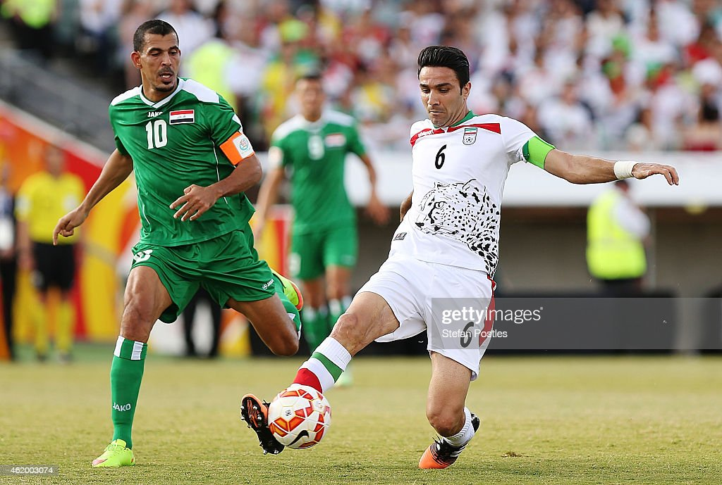 Javad Nekonam of Iran and Younus Mahmood of Iraq contest possession during the 2015 Asian Cup match between Iran and Iraq at Canberra Stadium on January 23, 2015 in Canberra, Australia.