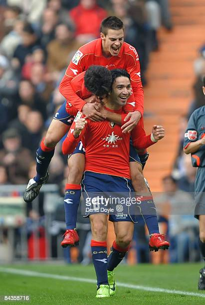 Javad Nekouman of Osasuna celebrates with teammates after scoring against Real Madrid during the La Liga match between Real Madrid and Osasuna at the...