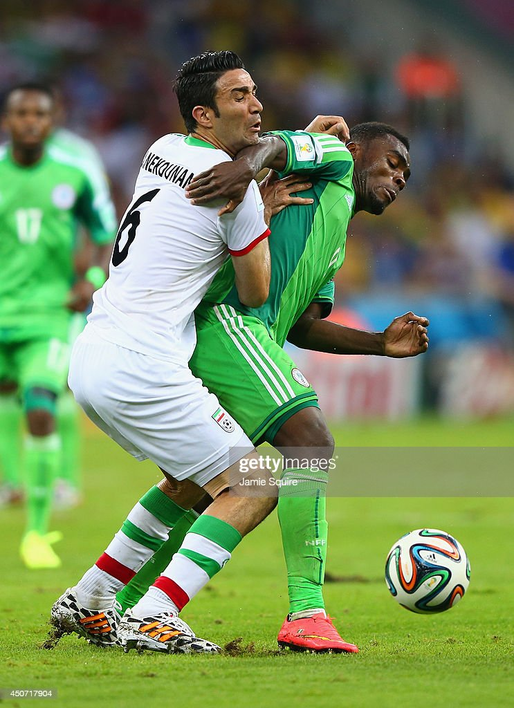 Javad Nekounam of Iran competes for the ball with Emmanuel Emenike of Nigeria during the 2014 FIFA World Cup Brazil Group F match between Iran and Nigeria at Arena da Baixada on June 16, 2014 in Curitiba, Brazil.