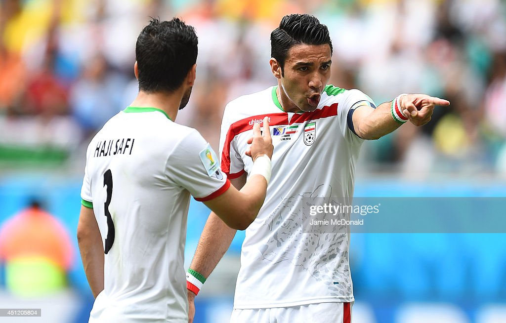 Javad Nekounam of Iran (R) gestures during the 2014 FIFA World Cup Brazil Group F match between Bosnia and Herzegovina and Iran at Arena Fonte Nova on June 25, 2014 in Salvador, Brazil.
