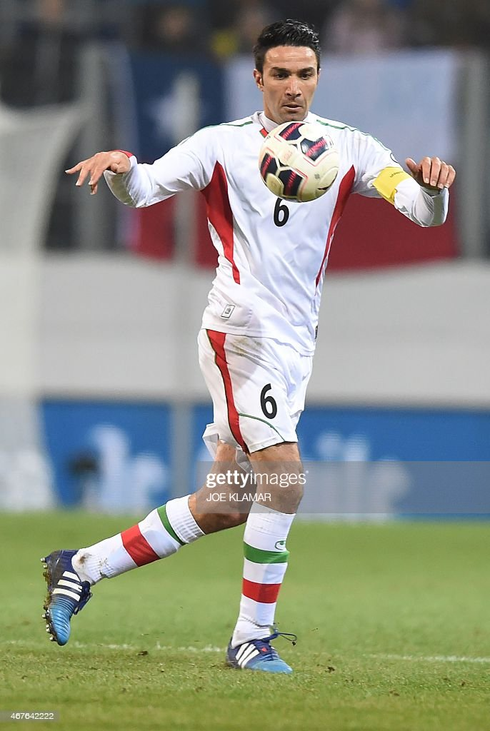 Javad Nekounam of Iran vies for the ball during the friendly football match Iran vs Chile in St. Poelten, Austria on March 26, 2015.
