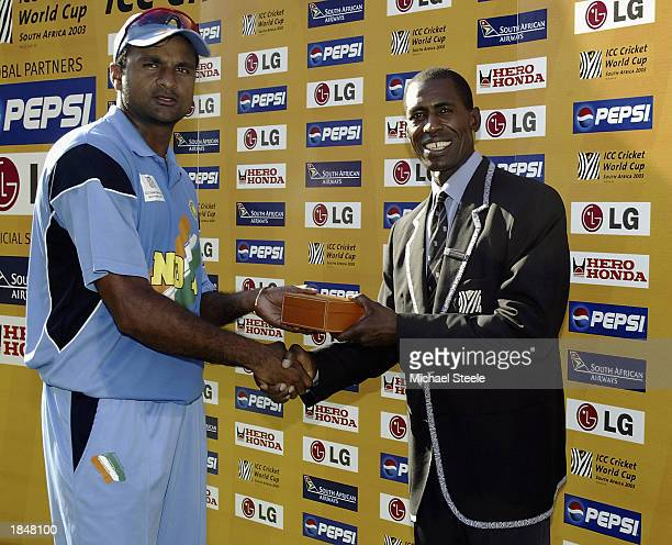 Javagal Srinath of India accepts the 'man of the match' award from Sydney Maree during the ICC Cricket World Cup 2003 Super Sixes match between Sri...