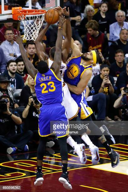JaVale McGee and Draymond Green of the Golden State Warriors defend Tristan Thompson of the Cleveland Cavaliers in the third quarter in Game 3 of the...