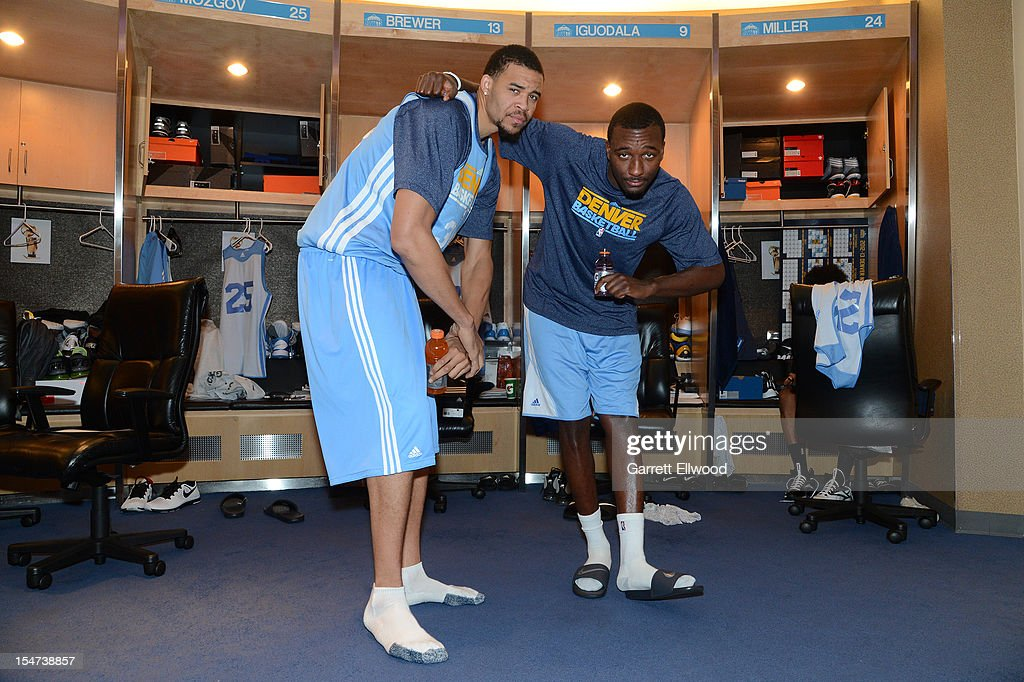 JaVale McGee #34 and Jordan Hamilton #1 of the Denver Nuggets pose for a photo prior to practice on October 24, 2012 at the Pepsi Center in Denver, Colorado.